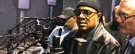 LEWITT booth at NAMM with Stevie Wonder testing the LCT 540 S